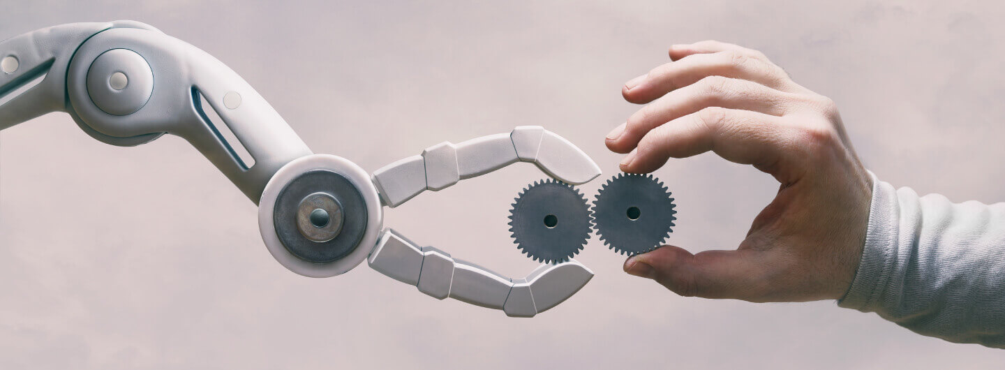 Human hand and machine hand collaborating together which depicts Human Machine Collabaration